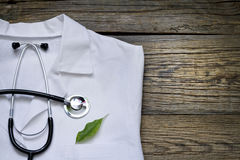 Alternative medicine stethoscope and green symbol background. Concept Royalty Free Stock Images