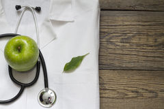 Alternative medicine stethoscope and green symbol background Stock Photography