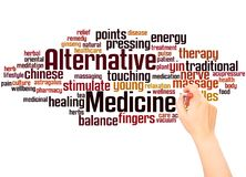 Alternative medicine word cloud and hand writing concept royalty free stock photography