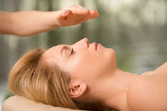Alternative medicine. Young beautiful women and her alternative medicine treatment Royalty Free Stock Photography