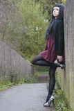 Alternative Model on Bridge in Dress. In british countryside stock photos