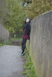 Alternative Model stood on a bridge. In british countryside royalty free stock images