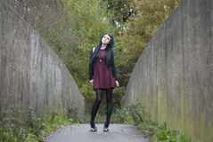 Alternative Model stood on a bridge. In british countryside stock image