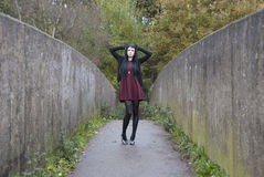 Alternative Model stood on a bridge. In british countryside stock photo