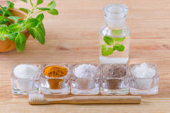 Alternative natural mouthwash with mint, toothpaste xylitol or soda, turmeric - curcuma, himalayan salt, clay or ash, coconut oil. And wood toothbrush, on stock photo