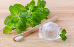 Alternative natural toothpaste himalayan salt and wood toothbrush, mint on wooden royalty free stock images
