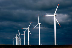 Alternative and nature-friendly energy production. Alternative energy provided by windmills getting the most out of a stormy day Stock Image