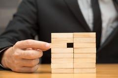 Alternative risk concept. Businessman choosing the wood block Royalty Free Stock Photo