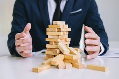 Alternative risk concept, plan and strategy in business protect. With balance wooden stack with hand control risk shape royalty free stock photography