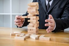 Alternative risk concept, plan and strategy in business, Risk To Make Business Growth Concept With Wooden Blocks, Images of hand royalty free stock images