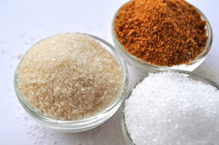 Alternative sweeteners - organic coconut sugar, xylitol, cane sugar,. In glass bowls stock photo