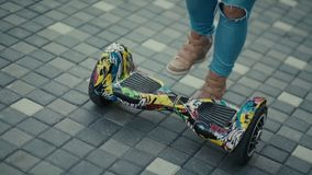 An alternative transport for young people. Gyroscooter, Blue lights. An alternative form of transport for young people. A popular means of transportation stock video