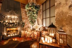Alternative tree upside down on the ceiling. Winter home decor. Christmas in loft interior against brick wall. Stock Image