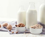 Alternative types of milks in glass bottles. Vegan non dairy milk royalty free stock image