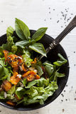 Alternative vegan salad with rocket, carrots chips, walnuts and seeds Royalty Free Stock Images