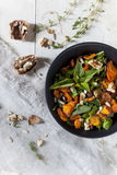 Alternative vegan salad with rocket, carrots chips, walnuts and seeds Royalty Free Stock Photo