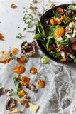 Alternative vegan salad with rocket, carrots chips, walnuts and seeds Stock Photo