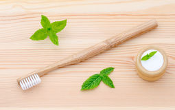 Alternative wood toothbrush and xylitol, soda, powder, salt, mint on wooden Royalty Free Stock Image