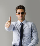 Alternative young business man wearing shirt, tie and ripped jeans Stock Photo
