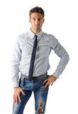 Alternative young business man wearing shirt, tie and ripped jeans Stock Photos