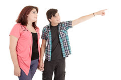 Alternative young couple pointing finger to empty Royalty Free Stock Image