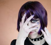 Alternative Young Woman with Purple Hair Stock Images