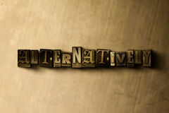 ALTERNATIVELY - close-up of grungy vintage typeset word on metal backdrop Royalty Free Stock Photography