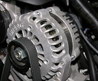 Alternator on an automobile. Royalty Free Stock Images