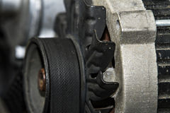 Alternator on a car. Automotive alternator from an automobile royalty free stock images