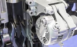 An alternator in engine. To generate electric stock photos