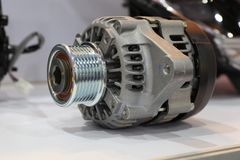 An alternator in engine. To generate electric stock images