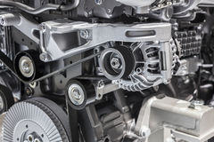 Alternator with flat drive belt. At modern truck engine stock photos