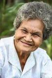 Altes asiatisches Frauenlächeln Stockfoto