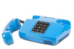 Altes blaues Schreibtischtelefon auf einem lokalisierten weißen Hintergrund Stockfoto