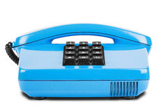 Altes blaues Telefon mit Schatten auf lokalisiertem weißem Hintergrund Lizenzfreie Stockbilder