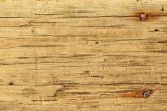 Altes Brett mit gehämmerten rostigen Nägeln Hintergrund für Titel lizenzfreie stockbilder