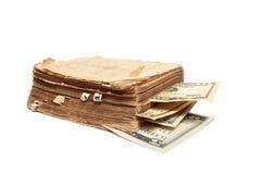 Altes Buch und Geld Stockfoto