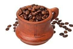 Altes Cup mit Kaffeebohnen Lizenzfreie Stockfotos