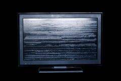 Altes Fernsehen auf schwarzem Hintergrund Lizenzfreies Stockbild