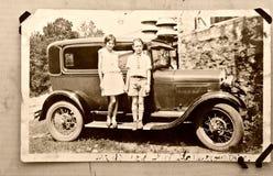 Altes Foto-Kind-Auto/1900 Stockfoto