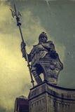 Altes Foto mit Metallstatue Lizenzfreie Stockbilder