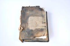 Altes gebranntes Bibelbuch stockfotos