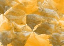 Altes gelbes Papier auf dunklem Hintergrund Lizenzfreie Stockfotografie
