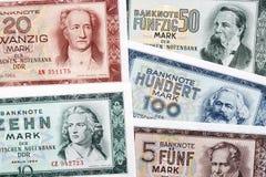 Altes Geld von Ostdeutschland, ein Hintergrund Stockfotos