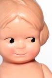 Altes glückliches Kindpuppeportrait Stockfotos