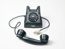 Altes grünes Telefon auf einem weißen Hintergrund Lizenzfreies Stockfoto