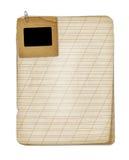 Altes grunge Notizbuch mit Plättchen stockbild
