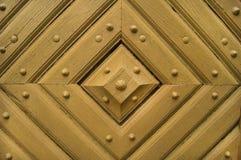 Altes hölzernes Muster auf der Tür stockfoto