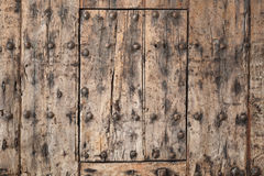 Altes hölzernes Torfragment, Hintergrundbeschaffenheit Lizenzfreies Stockbild