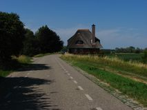 Altes Haus mit Strohdach stockfoto